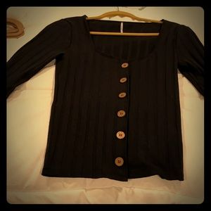 Free people black blouse with buttons.